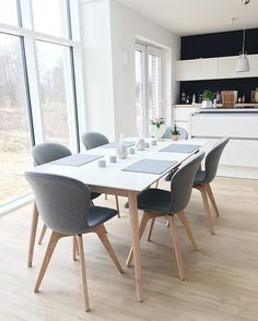 @vickyhellmann has captured the essence of Scandinavian style by pairing the white and oak Milano table with Adelaide chairs in oak and grey felt. #BoConcept #diningroom #scandinavianhome #minimalmood #interiorinspiration