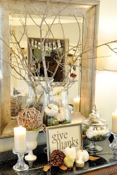 Working on a little more fall decorating here at home this week. Moved some things around and changed out the decor of the large crystal jar I keep on there. Went hunting in the backyard from some twigs and leaves to add some more natural elements but kept it simple and used what I had from last year as I did with the dining room tablescape.