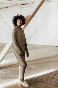 Stay cozy throughout the holiday chaos in this relaxed-fit sweater featuring a cowl neckline and dolman sleeve. Available in black, cream, and two grays, this sweater will not only be a wardrobe staple this winter, but makes a great gift for friends and family! #fashion #giftsforher #winterfashion #winteroutfit #christmassweater #sweaters #sweaterweather #cozysweater #winterwhites