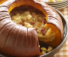 Roasted Pumpkin Stuffed with Bread, Cheese and Cream