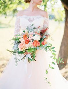 Peach + greenery wedding bouquet idea - overflowing wedding bouquet with roses, dahlias, ranunculuses, seeded eucalyptus, rosemary, stock and silver brunia {Ben Q. Photography}