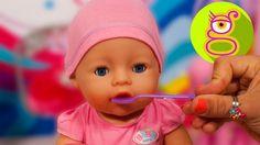 Cuidamos a la bebé Claudia - Baby Born - vídeos de bebés - juguetes en e...