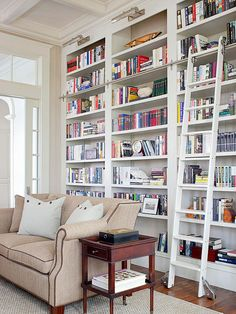 For a large book collection, tilt books in different directions to make the entire bookcase look more visually interesting. Books can be stacked horizontally on top of one another, vertically, and even lean at an angle to add visual rhythm to a bookcase filled to the brim.