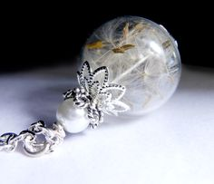 A personal favorite from my Etsy shop https://www.etsy.com/listing/207830741/dandelion-necklace-silver-make-a-wish