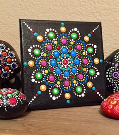 """This is a one of a kind, handpainted mandala canvas. It was painted with acrylics using a dotting technique. This """"ready to hang"""" canvas measures 5"""" x 5"""" and is 1/2"""" thick. Mandalas are sacred symbols used for meditation, prayer, healing and art therapy for both adults and children."""