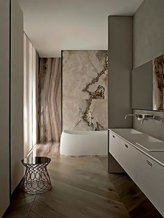Milan apartment of Svetlana Irzhavskaya by Patricia Urquiola - 'Pear' bath for Agape, mosaics by Mutina, 'Re-trouve' stool Emu
