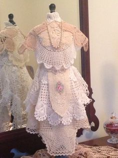 Dress form covered with antique doilies collected over many years..
