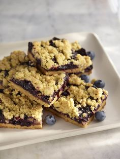 Blueberries and corn are brilliant together. These blueberry bars incorporate the sweet crunch of cornmeal in the crust and topping along with the bright, tart notes that come from adding fresh lemon juice and zest to the blueberry filling.