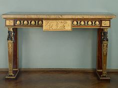 "Twin Console Tables Decorated with the ""Honouring of Virgil"" Relief France. Paris. Early 19th century Mahogany, bronze and yellow and pink marble; carved, gilded and patinated. 96x137x55 cm Source of Entry:   State Museum Fund. 1920s"