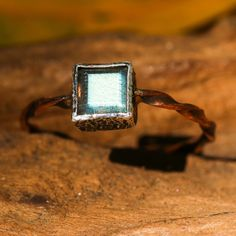 Square faceted labradorite ring in silver bezel setting with copper twist design band