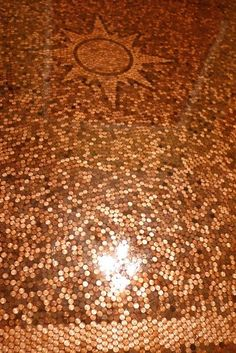 Who knew decorating with pennies was so popular? I love the sun design in this floor layout.  Money Floor | Cindy Aplanalp Interiors.... By Design