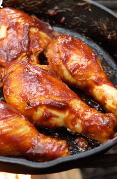 This BBQ chicken made over the campfire in a cast iron skillet makes a delicious camping dinner! Homemade BBQ sauce made with whiskey slathered on chicken legs and thighs that are cooked over the open fire. Cast Iron Chicken Recipes, Iron Skillet Recipes, Cast Iron Recipes, Family Meal Planning, Family Meals, Campfire Dinner Recipes, Bbq Chicken Legs, Homemade Bbq, Cast Iron Cooking