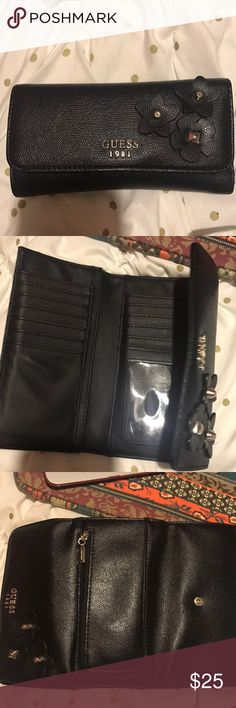 Guess Wallet This GUESS Wallet has many pockets to hold cards, coins, and cash! There is a license pocket that is great for easy use. The wallet is all black, as you can see  from the pictures and it has light wear to it but no tears or anything like that. Guess Bags Wallets