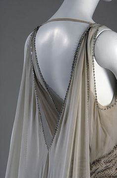 Gown 1938  Smoke-gray chiffon, rhinestones and silver beads. Worn by Mrs. Potter Palmer II when she was presented to the Queen of England in 1938.
