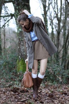 like the skirt with the boots and knee high socks: tan skirt, knee socks, brown leather boots, blue button up, cowl scarf, coat *