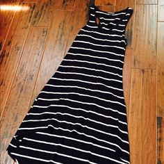 Black and white High low dress Very cute black with white stripes high low dress.  Small pocket at top. Worn once 60% cotton 40% modal Express Dresses High Low