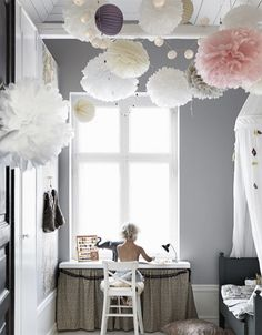 paper pom poms in scandinavian kids bedroom / sfgirlbybay