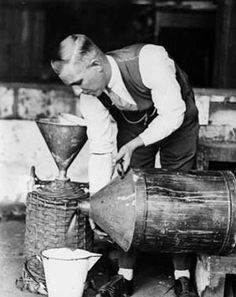 A picture of a man creating alcohol to bootleg, or sell illegally mainly during prohibition