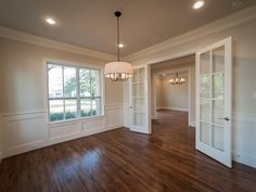 The study has double French doors and wainscoting