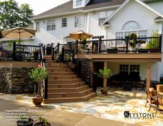 TimberTech Legacy Tigerwood with Mocha Border and TimberTech Black Radiance Rails with Round Aluminum Balusters. Also Featuring Custom Steps, Stone Work, and a Patio. Built By Keystone Custom Decks.