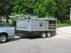 The trailer was originally a car carrier; the boxes, rack, and stake sides have been added. Note the double doors on the front of the trailer—they open directly into the bed. Work Trailer, Utility Trailer, Open Trailer, Trailer Hitch, Trailer Storage, Tool Storage, Storage Spaces, Welding Trailer, Truck Canopy