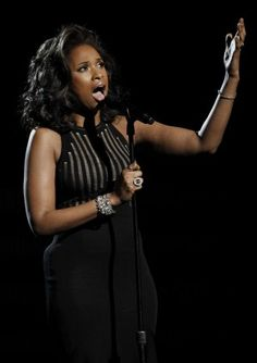 """Jennifer Hudson performs """"I Will Always Love You"""" during the In Memoriam portion of the 54th annual Grammy Awards on Sunday, Feb. 12, 2012 in Los Angeles"""