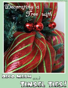 Decorating a Christmas tree with tinsel ties and deco mesh