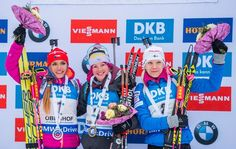 (L-R) Second placed Gabriela Koukalova of Czech Republic, winner Marie Dorin Habert of France and third placed Kaisa Makarainen of Finland celebrate on the podium after the women´s 10 km pursuit race of the IBU Biathlon World Cup in Oberhof, eastern Germany, on January 7, 2017. / AFP / Robert MICHAEL