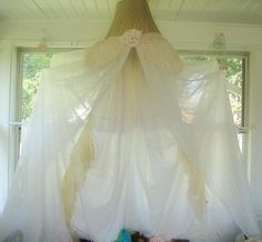 Bed Canopy or tent made from a lamp shade, repurposed sheers, sheets or wedding dress. Boy themed one also.