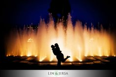 I like the pose with the fountain in the background to make it look romantic