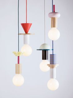 "Geometric coloured timber components stack to create quirky pendant lights. ""Modular geometric pendant lights by the northern-German design studio Schneid""."