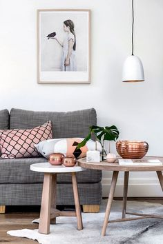 Don't love the art or pillow but I love the rug, tables and copper accents.