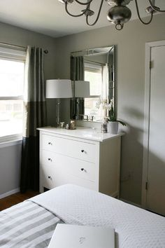 Grey and white bedroom. I have this dresser from Ikea and like the look of this.