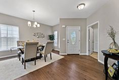 This new construction ranch-style home in Columbia, IL is perfect for young couples or empty-nesters. Home Staging Companies, Young Couples, Ranch Style, New Construction, Empty, Columbia, Dining Table, Room, Furniture