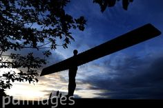 The sun sets over the Angel Of The North in Gateshead.