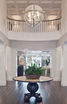 This two story foyer is simply elegant! We love the chandelier in particular! From Brooke Wagner Design