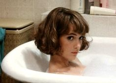 winona ryder looking more full-on girly than we typically see her in a bob with golden highlights