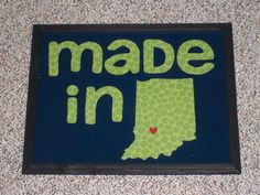Made this picture for my son's nursery for less than five $ inspired by another pin I found - I purchased an 11 x 20 frame at the Dollar Tree, glued fabric to the backing, cut out the letters and state from a piece of white poster board and spray painted it navy, glued it on top of the fabric covered backing and then added the red heart in place of our city and ta da super cute nursery art - you could customize this so many ways and it's so cheap and easy - I made in about an hour!