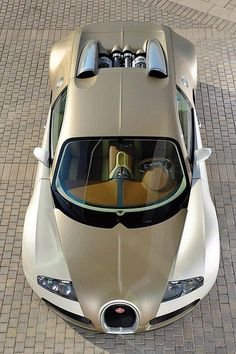 bugatti veyron grand sport......My Goodness. How pretty is that color!!!! Vanilla on Pearl(looks Like)