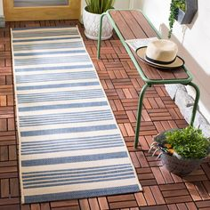 Featuring a breezy stripe motif in blue and beige, this lovely rug brings cabana-inspired style to any alfresco space. Add it to the sunroom for a subtle touch of color, or let it lend a pop of pattern to your stylish patio seating ensemble. Indoor Outdoor Area Rugs, Outdoor Decor, Outdoor Spaces, Patio Seating, Backyard Patio, Decoration, Blue Area Rugs, Home And Garden, Beige