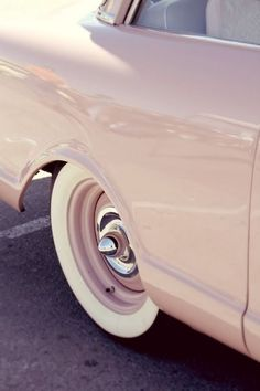 pink vintage car at the primer nationals in ventura, california