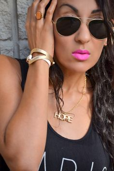 Wood ring, leather bracelet, hope necklace, candy yum yum lipstick, aviator sunglasses
