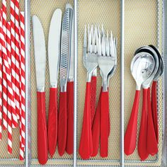 Red cutlery and straws