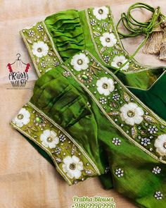 No photo description available. Blouse Designs Silk, Bridal Blouse Designs, Blouse Patterns, Mirror Work Blouse Design, Raw Silk Fabric, Maggam Work Designs, Kids Frocks Design, Hand Work Embroidery, Stylish Blouse Design