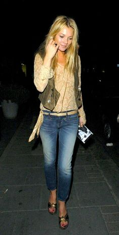 Kate Moss Kate Moss showing off her famous skinny jeans and waistcoat combo during London Fashion Week - September, 2004