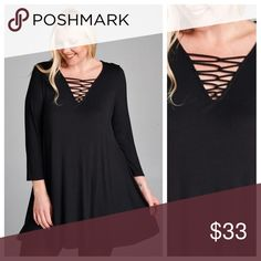 Black Top With Strappy Criss-Cross Neck Black top with strappy criss-cross neckline and cropped sleves. Fabric is soft and swingy. EVIEcarche Tops