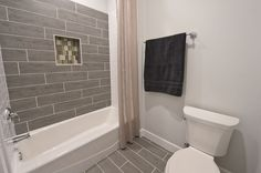 """Contemporary Full Bathroom with Daltile Fabrique 6"""" x 24"""" Unpolished Field Tile in Noir Linen, High ceiling, Hardwood floors"""