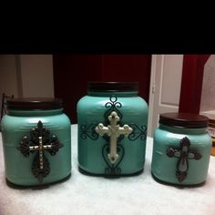 homemade canisters with some spray paint, hot glue gun and some hobby lobby great finds! Super simple and fun to make...