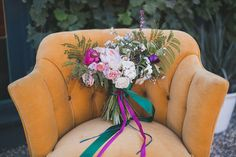 purple ribbon bouquet in vintage chair