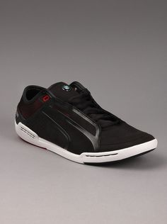 Puma® Mens BMW Street Tuneo Low Sneakers in Black.  Show some street style on the court in these BMW mens trainers from Puma. Low profile style and prominent BMW logo make these athletic shoes an exceptional buy. If you're looking for quality mens basketball shoes with some street appeal, these should be your number one choice.